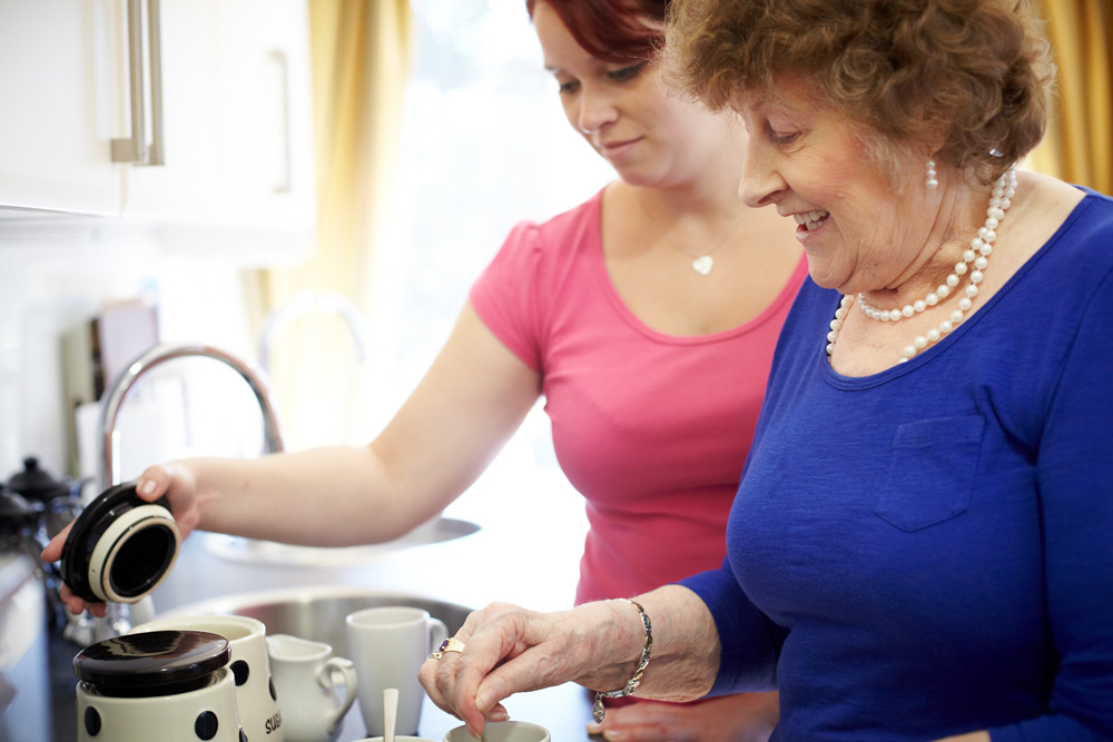 Resident and carer make a cup of tea